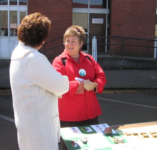 karen-greeting-visitor-at-earth-day-coho-booth