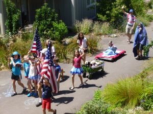 Coho musicians in a rousing Stars and Stripes Forever. Lots of parade waves. Is that a wagon full of stuffed animals?
